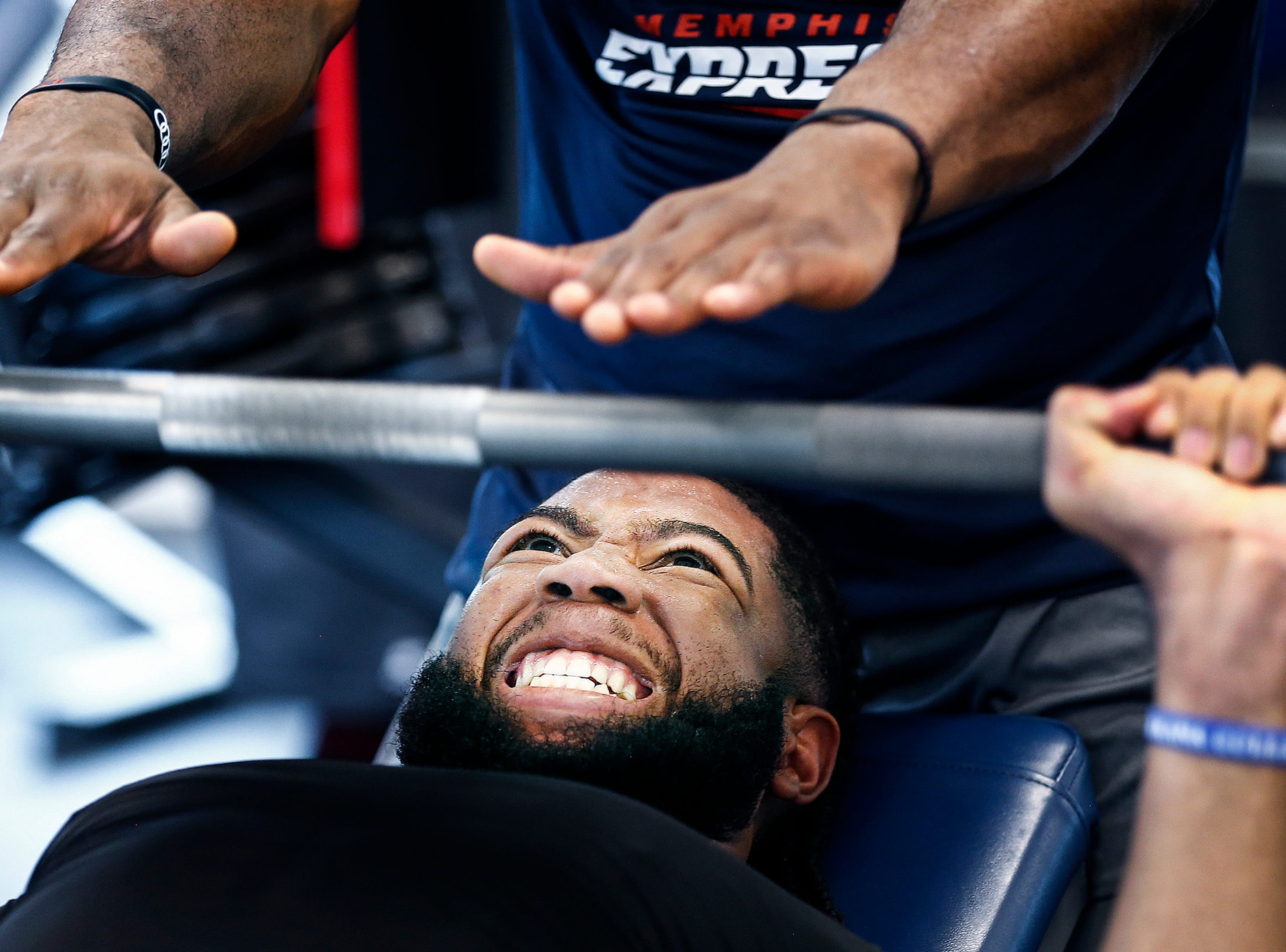 Memphis Express linebacker Anthony Rhone lifts weights during training camp in San Antonio, Texas.