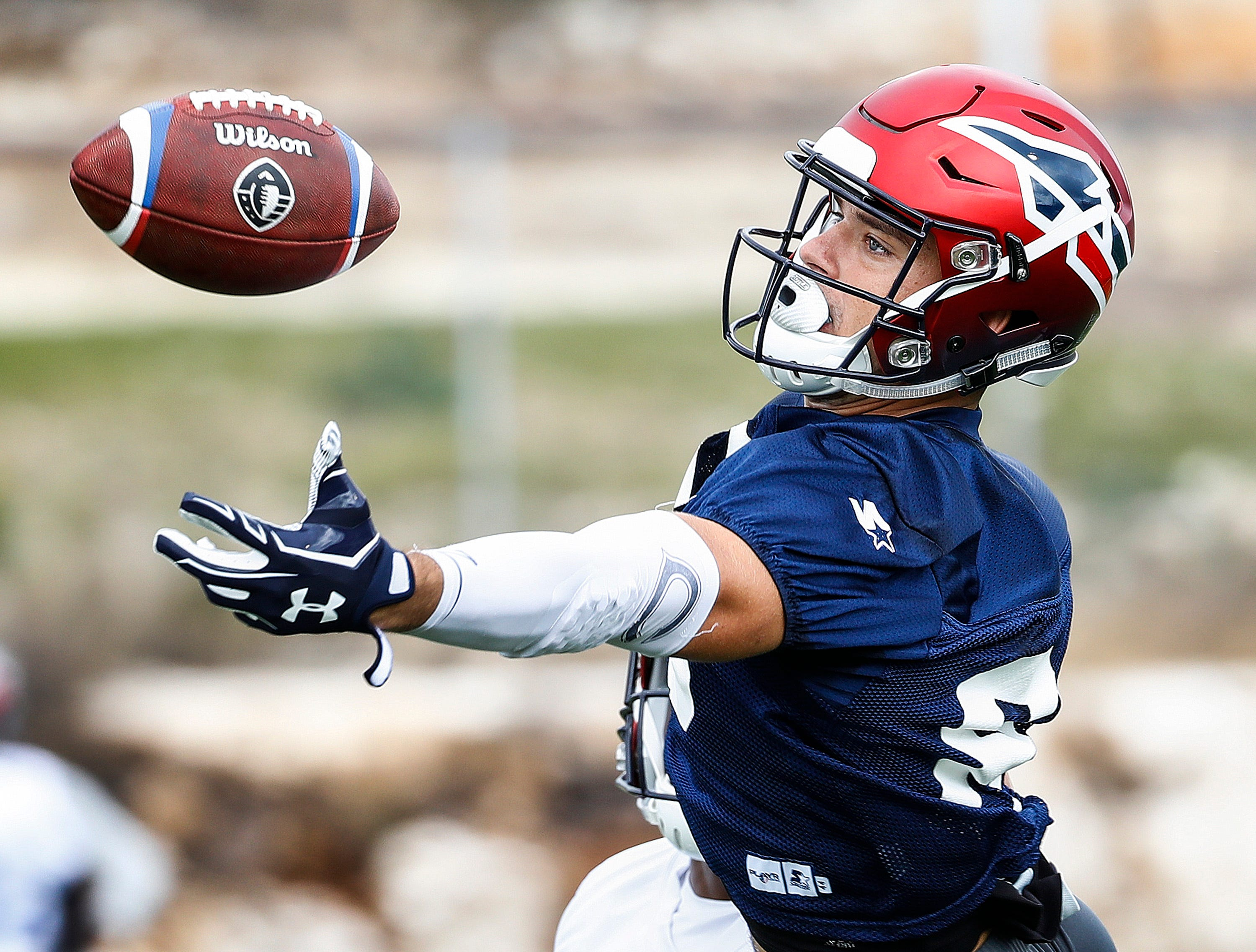 Memphis Express receiver Fabian Guerra (right) can not haul in a catch against defender Terrell Bonds (left) during training camp in San Antonio, Texas.