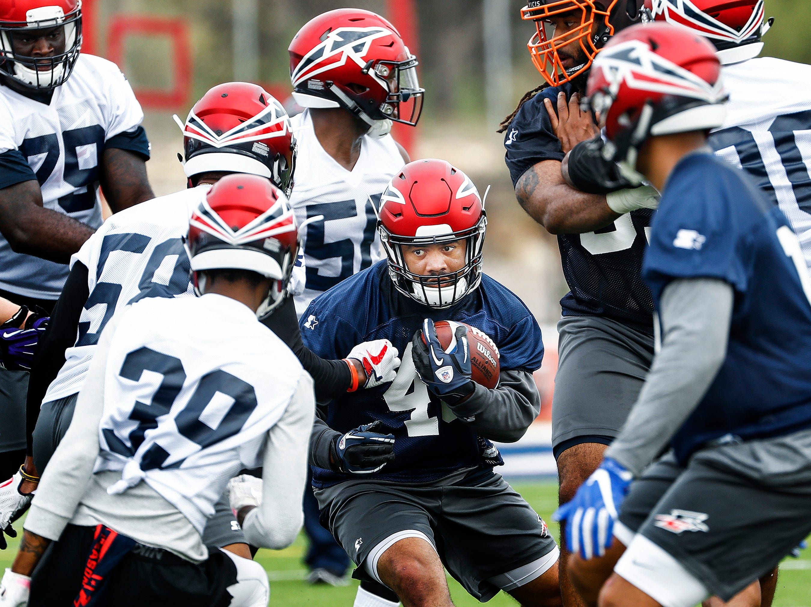 Memphis Express running back Kenny Hilliard looks for a lane during training camp in San Antonio, Texas.