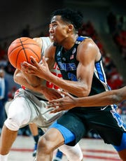 Memphis guard Jeremiah Martin drives the lane against the Houston defense on Sunday.