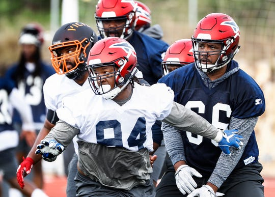 Memphis Express defensive lineman Latarius Brady (front) during training camp in San Antonio, Texas.