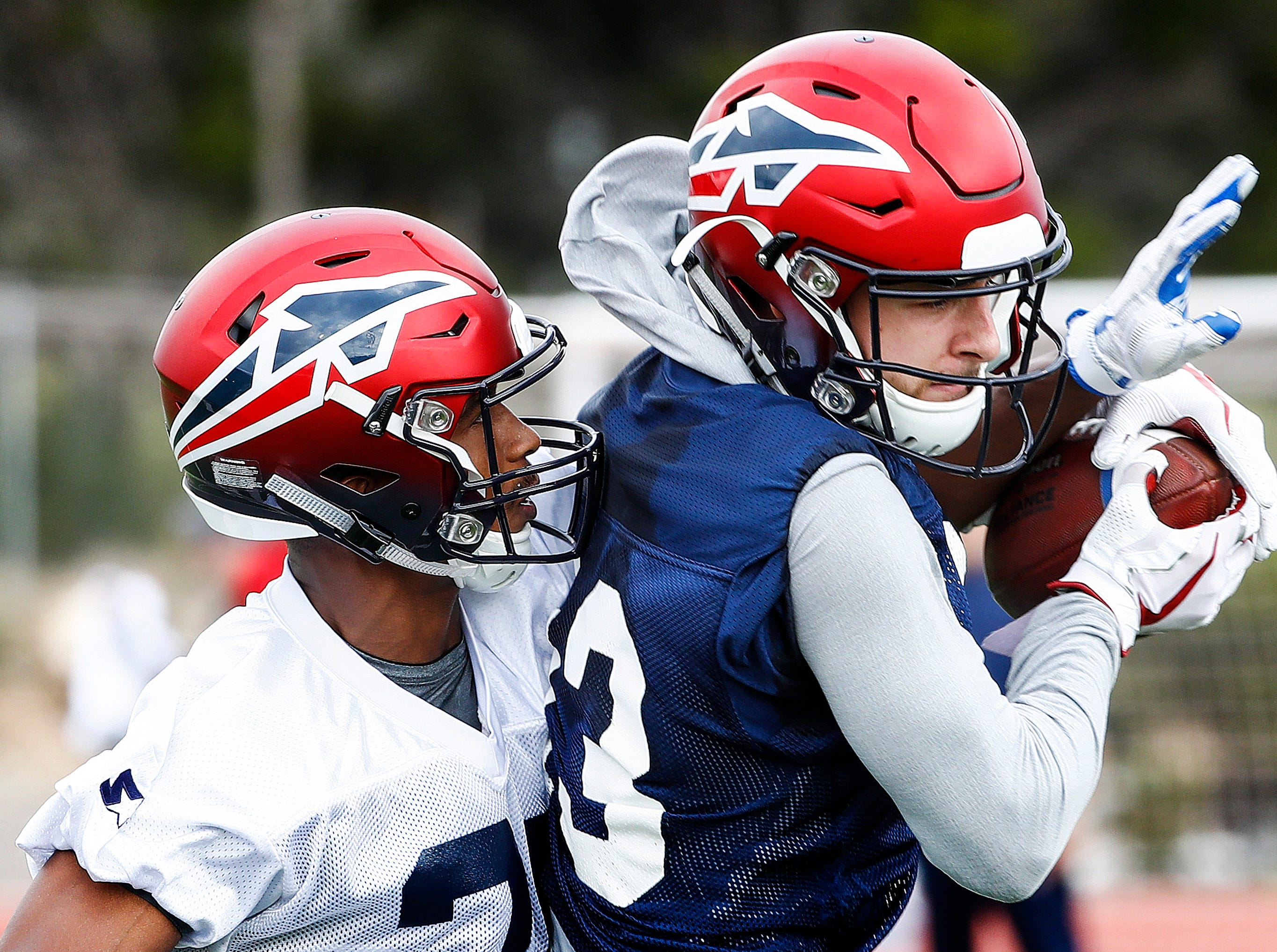 Memphis Express receiver Drew Morgan (right) makes catch in front of defender Jonathan Cook (left) during training camp in San Antonio, Texas.