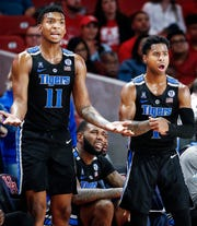 Memphis teammates Antwann Jones (left) and Tyler Harris (right) are not happy with an officials call during action against Houston.