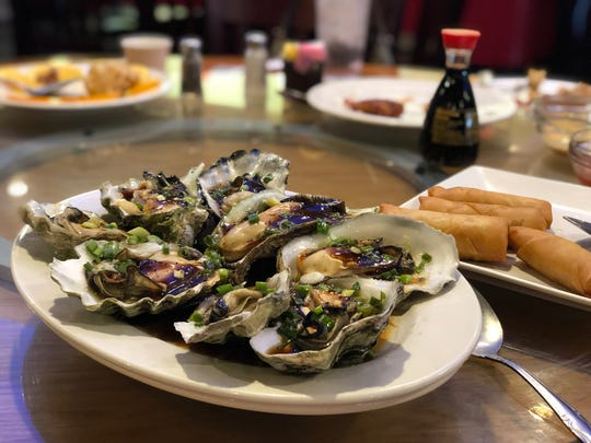 Steamed Oysters in the Half Shell with Black Bean Sauce are served at Golden City.