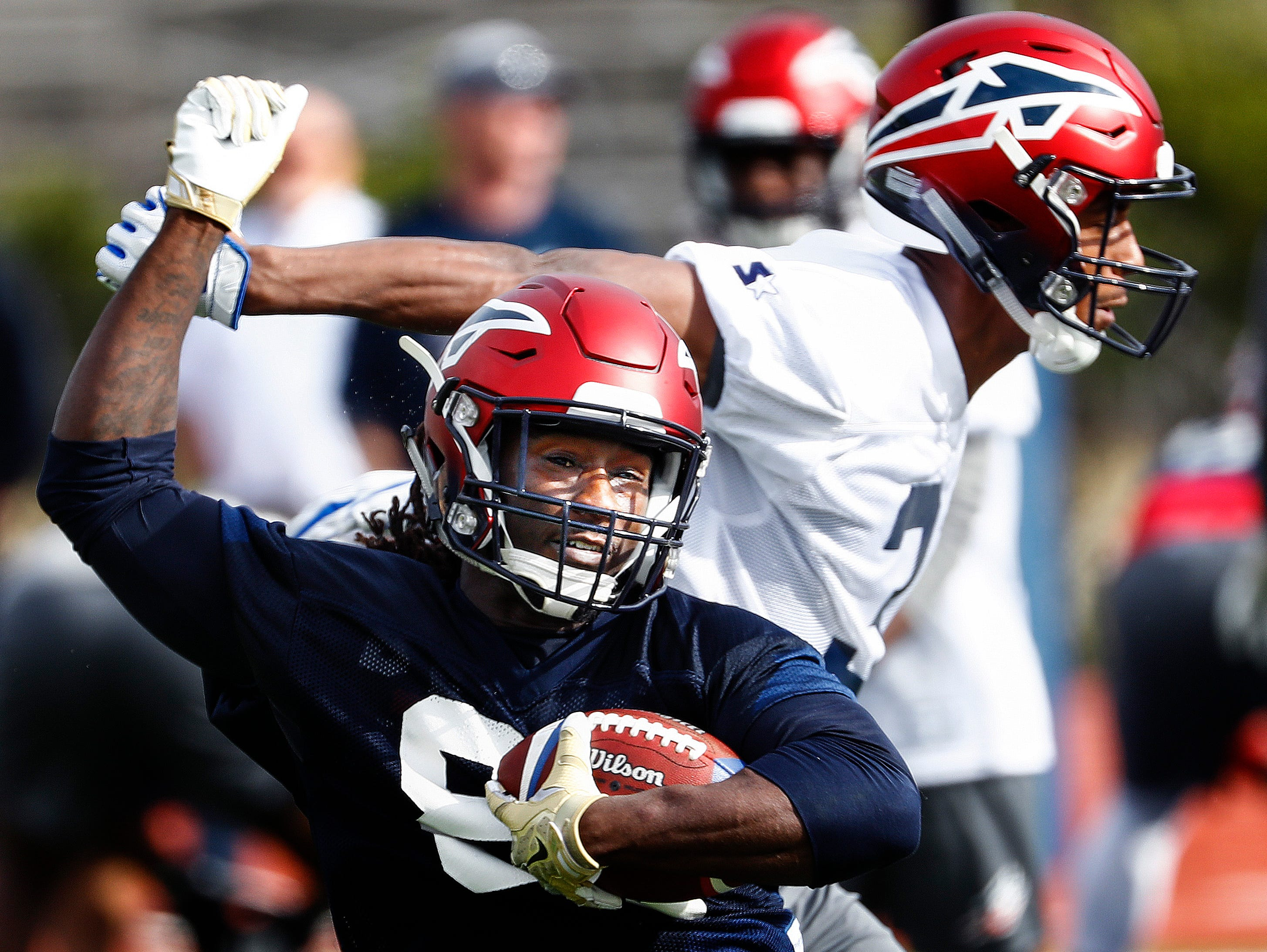"Memphis Express receiver Alton ""Pig"" Howard (front) makes a catch in front of defender Jonathan Cook (back) during training camp in San Antonio, Texas."