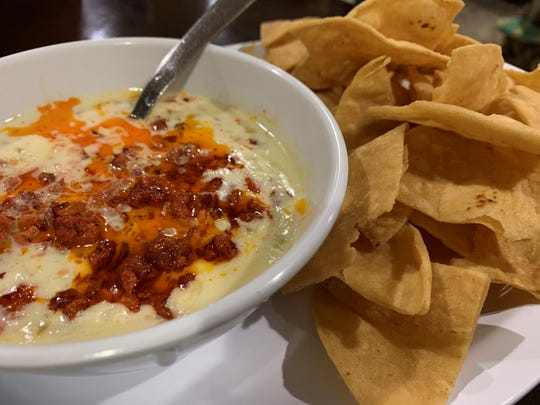 Queso featuring chorizo, served with chips, at Taqueria San Julian, Naples.