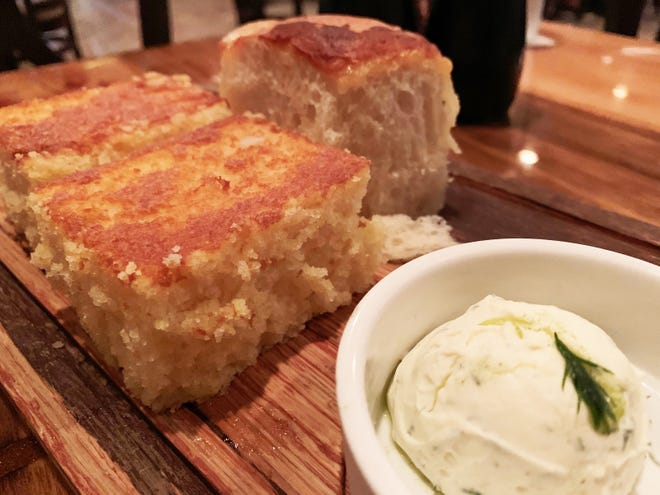 Gratis breads before dinner at The Oyster Society, Marco Island, include a sweet cornbread and a petit brioche.