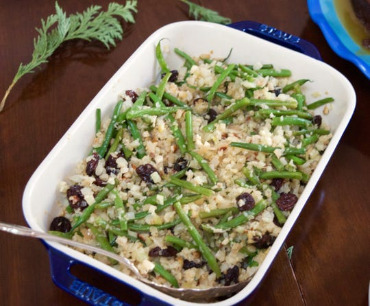 Cauliflower Rice with Green Beans, Almonds and Raisins replaces less-healthy fries or chips as a side to burgers.