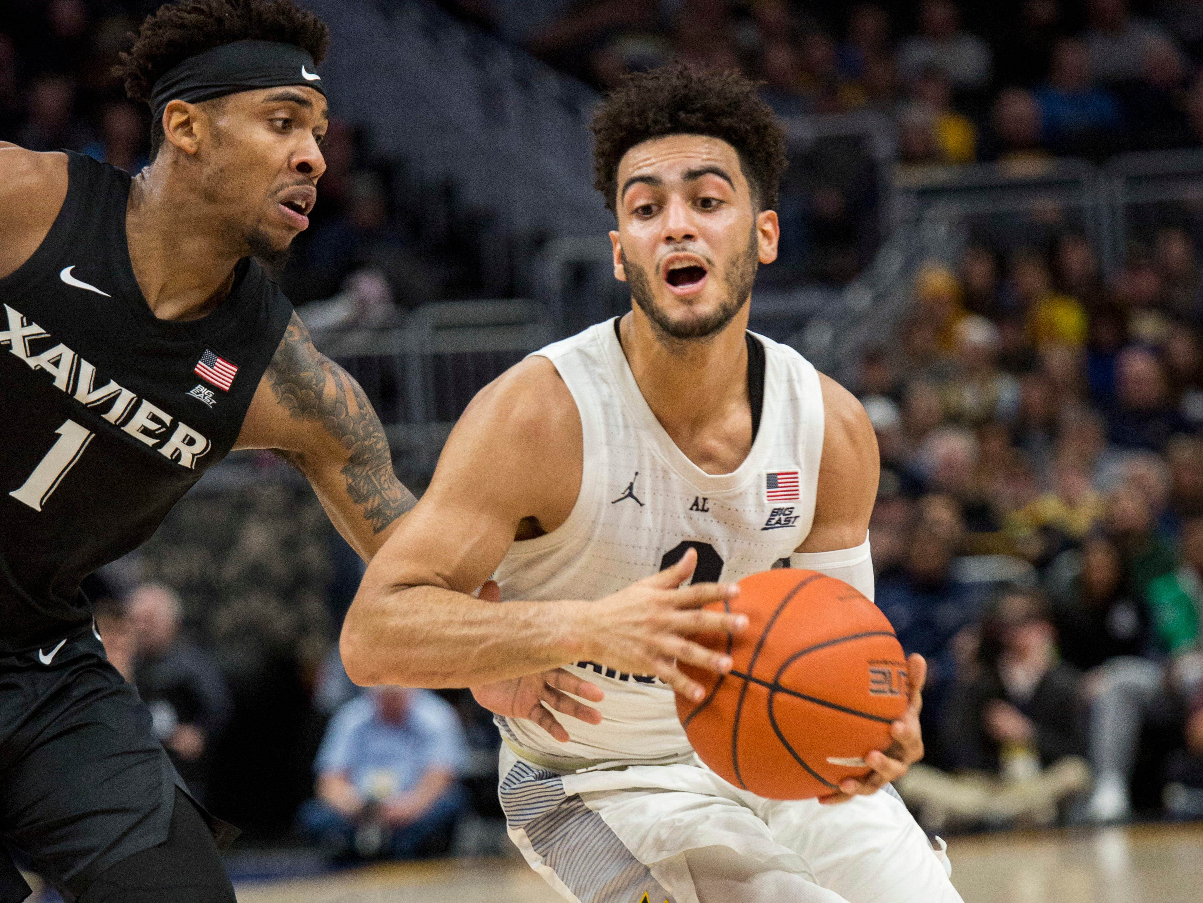 Marquette guard Markus Howard, who scored a game-high 26-pionts,  drives to the basket against Xavier guard Paul Scruggs on Sunday.