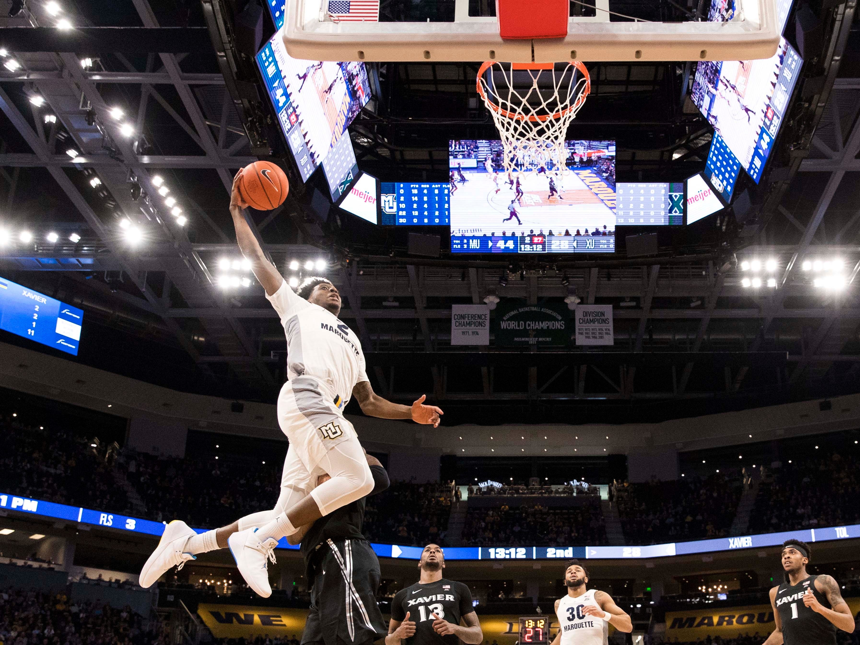 Marquette forward Sacar Anim swoops in for a dunk during the second half against Xavier on Sunday.