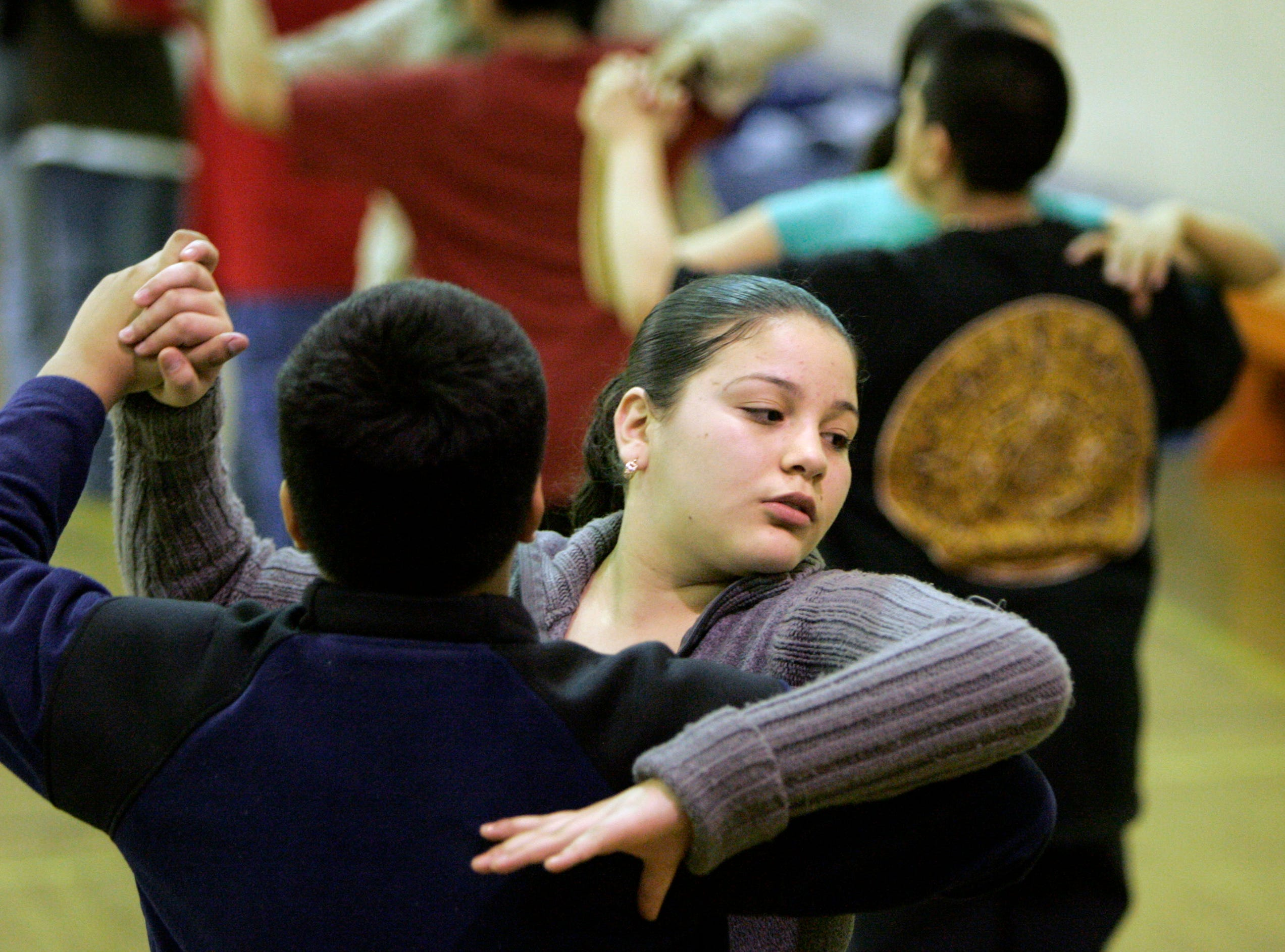 2007: Francisco Contereras, left, swirls his partner Abigail Rivera across the dance floor during dance rehearsal at Vieau School in Milwaukee on April 27, 2007. The school is one of twenty-five Milwaukee schools are participating in upcoming Mad Hot Ballroom competition.