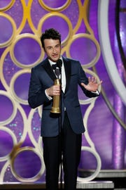 "Justin Hurwitz accepts the Golden Globe for his original score for ""First Man"" at Sunday night's Golden Globe Awards."