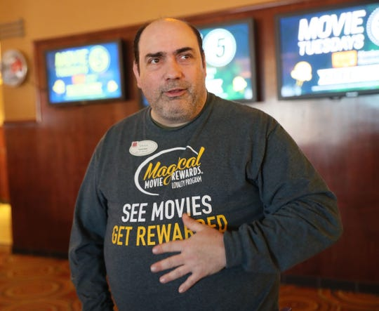 "Michael ""Spider"" Ryan takes tickets at the Marcus North Shore Cinema in Mequon."