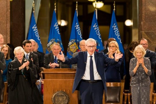 Newly sworn-in Gov. Tony Evers acknowledges the crowd during the inauguration.