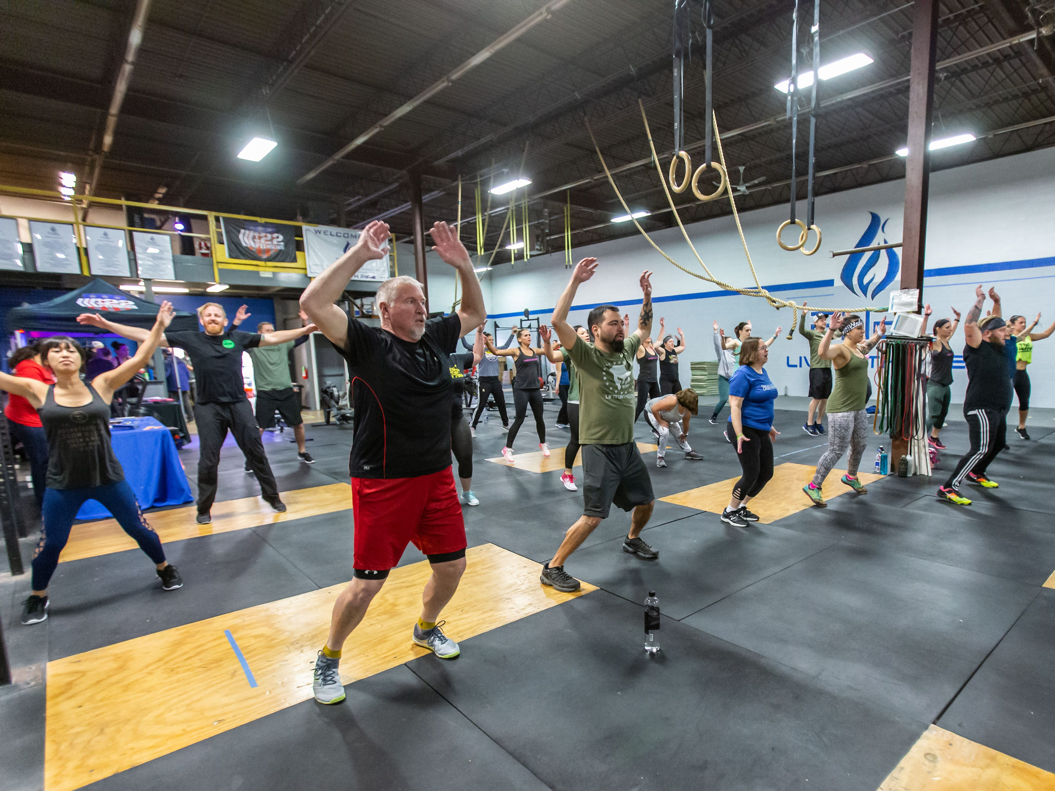Participants work out during a weekly free fitness class taught by Army veteran Dan Newberry at FUEL Fitness in Oak Creek on Sunday, Jan. 6, 2019. Dan's organization, 22 Fitness Foundation Inc., is collecting donations for the American Foundation for Suicide Prevention (AFSP). The Jan. 6 class was a fundraiser and informational gathering for the AFSP.