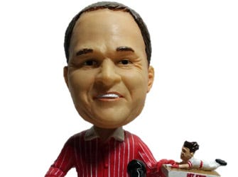 A bobblehead holding a bobblehead (Both are Pete Rose).
