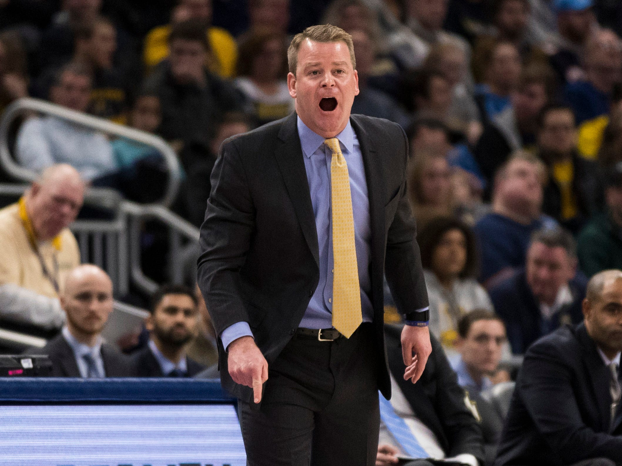 Marquette coach Steve Wojciechowski barks orders to his player during the first half against Xavier on Sunday.