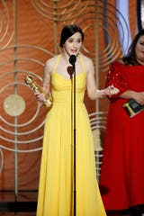 "Rachel Brosnahan accepts the Golden Globe for best actress in a TV comedy or musical series, for her performance on ""The Marvelous Mrs. Maisel."""