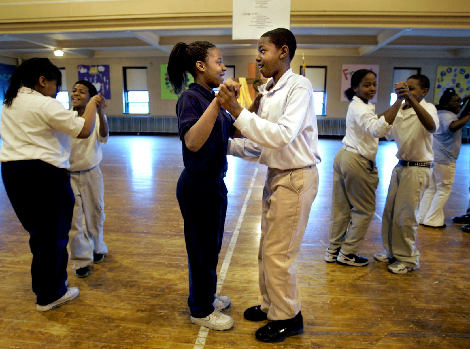 2017: St. Rose Catholic Urban Academy students Mishayla Jones, left, and her partner Jordan Miller practice their ballroom dancing on April 25, 2007. The Mad Hot Ballroom project, started 8 months ago, is  organized locally by Danceworks Performance Company and originally involved 25 Milwaukee schools.