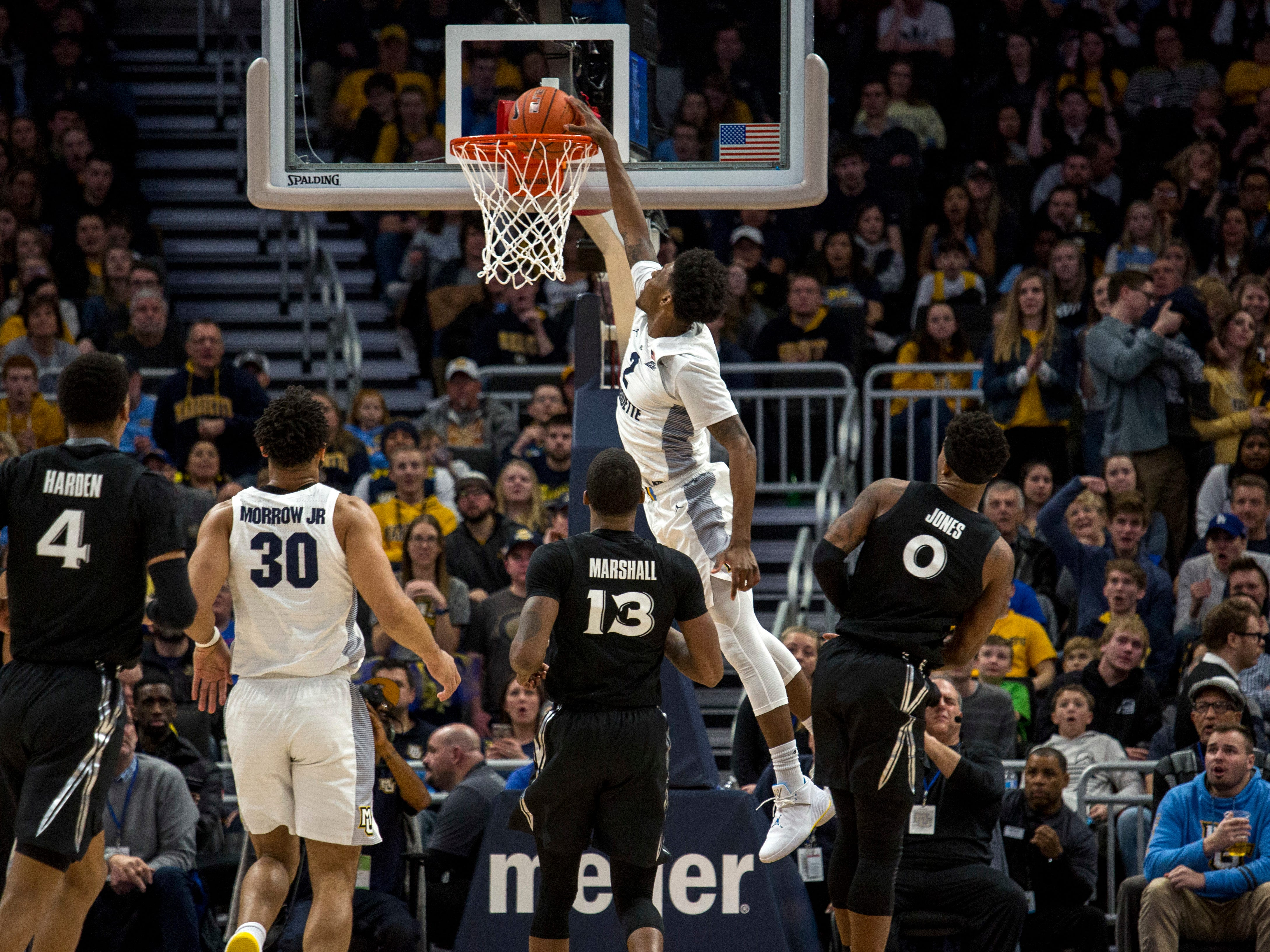 Marquette forward Sacar Anim finishes a fastbreak with a dunk against Xavier during the second half on Sunday.