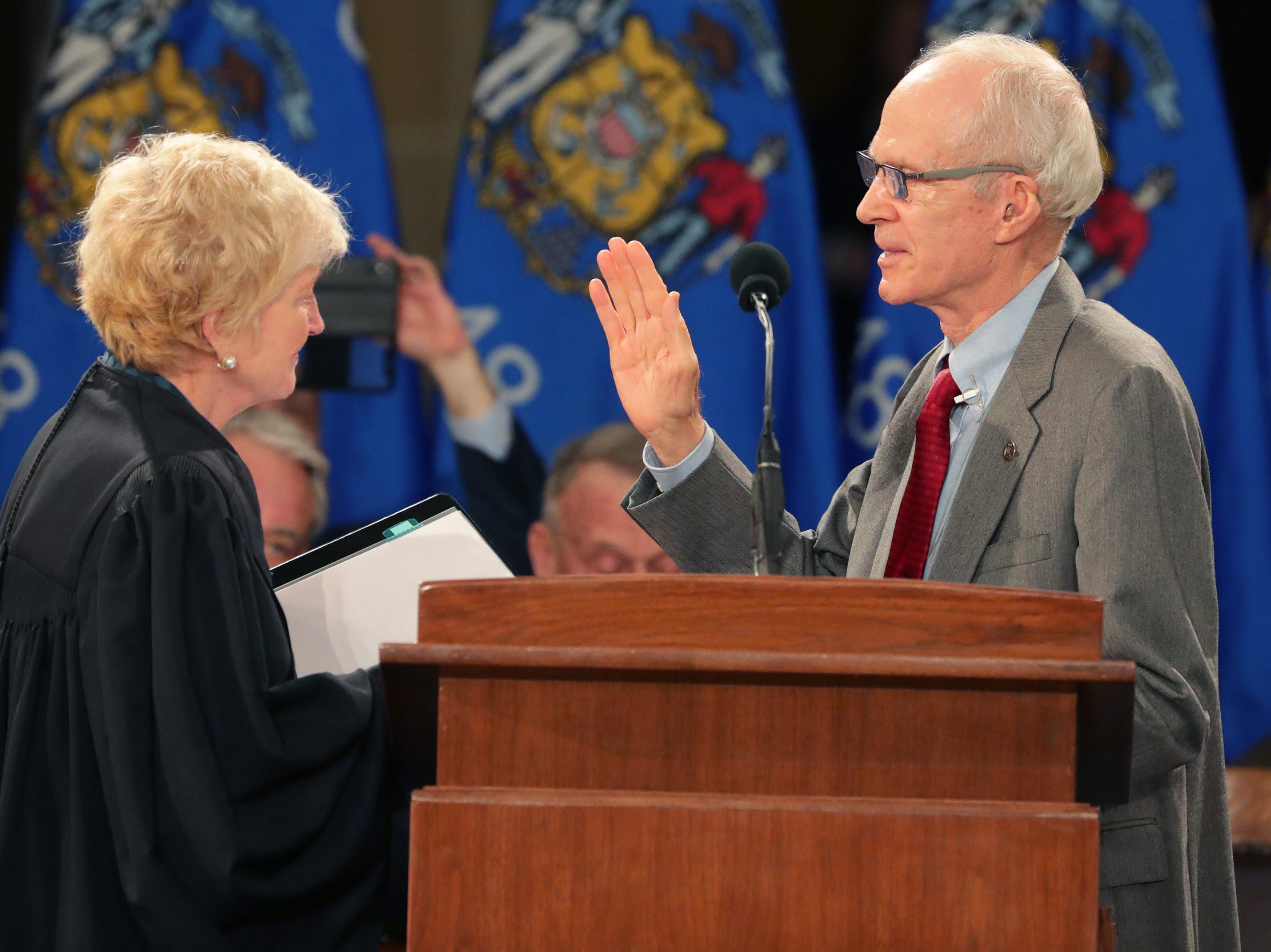 Chief Justice Patience D. Roggensack (left) administers the oath of office to Secretary of State Douglas La Follette.