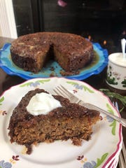 Toffee pudding cake is served warm with creme fraiche.