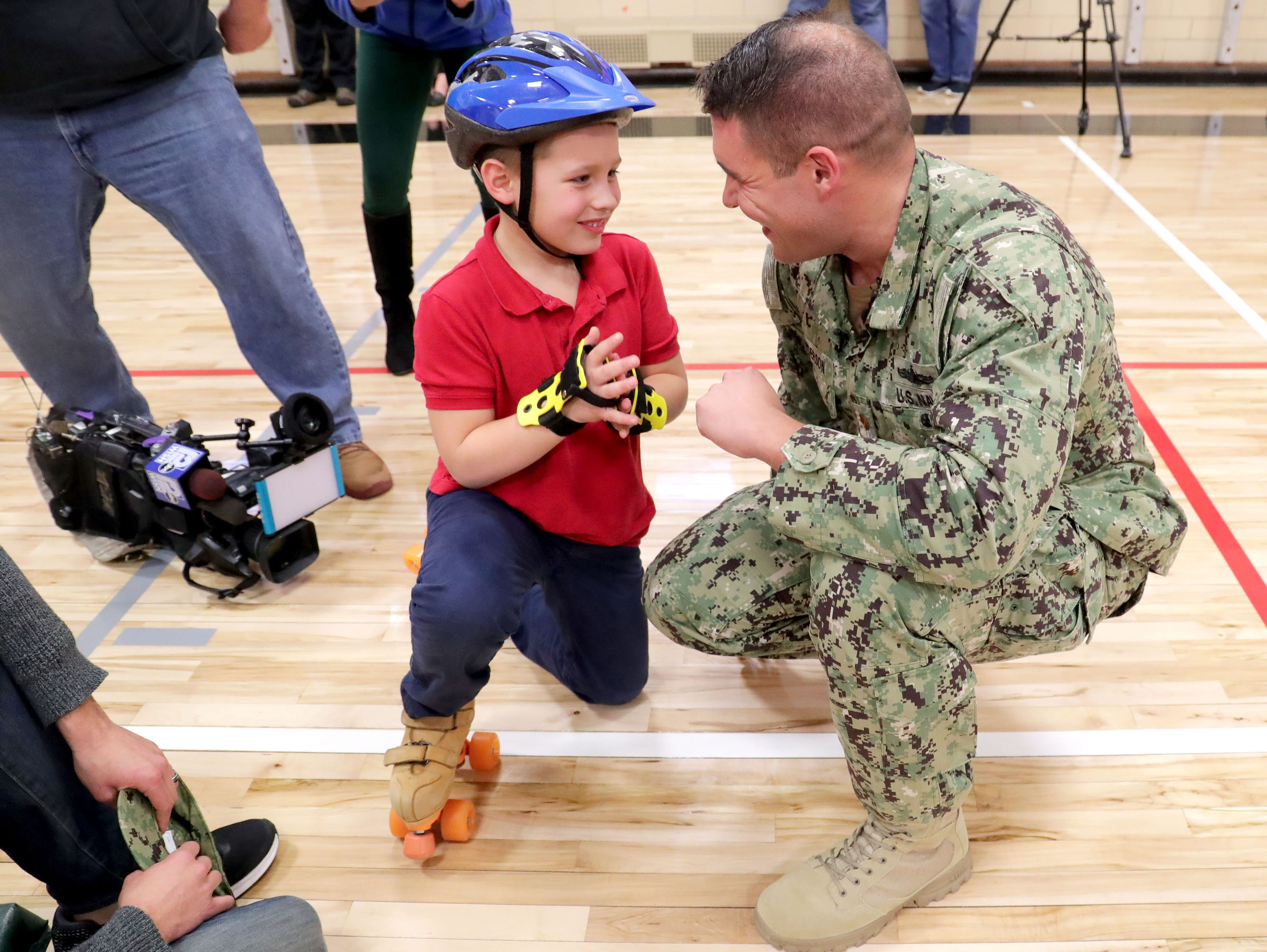 Ethan Anderson talks with his father, Navy Lt. Cmdr. Jon-Andrew Anderson-Ingebrigtsen.