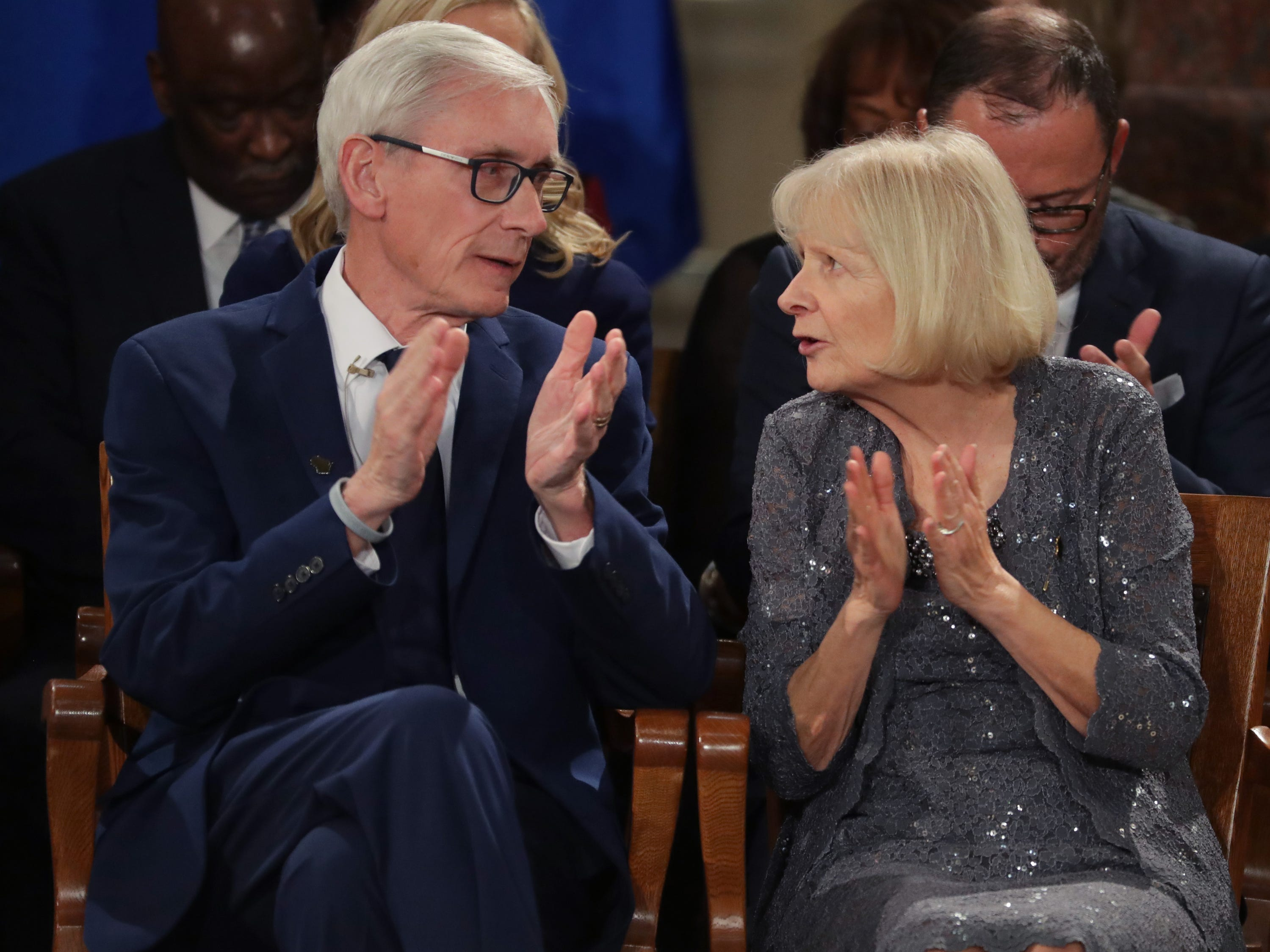 Incoming Gov. Tony Evers speaks to his wife, Kathy, during the inauguration.