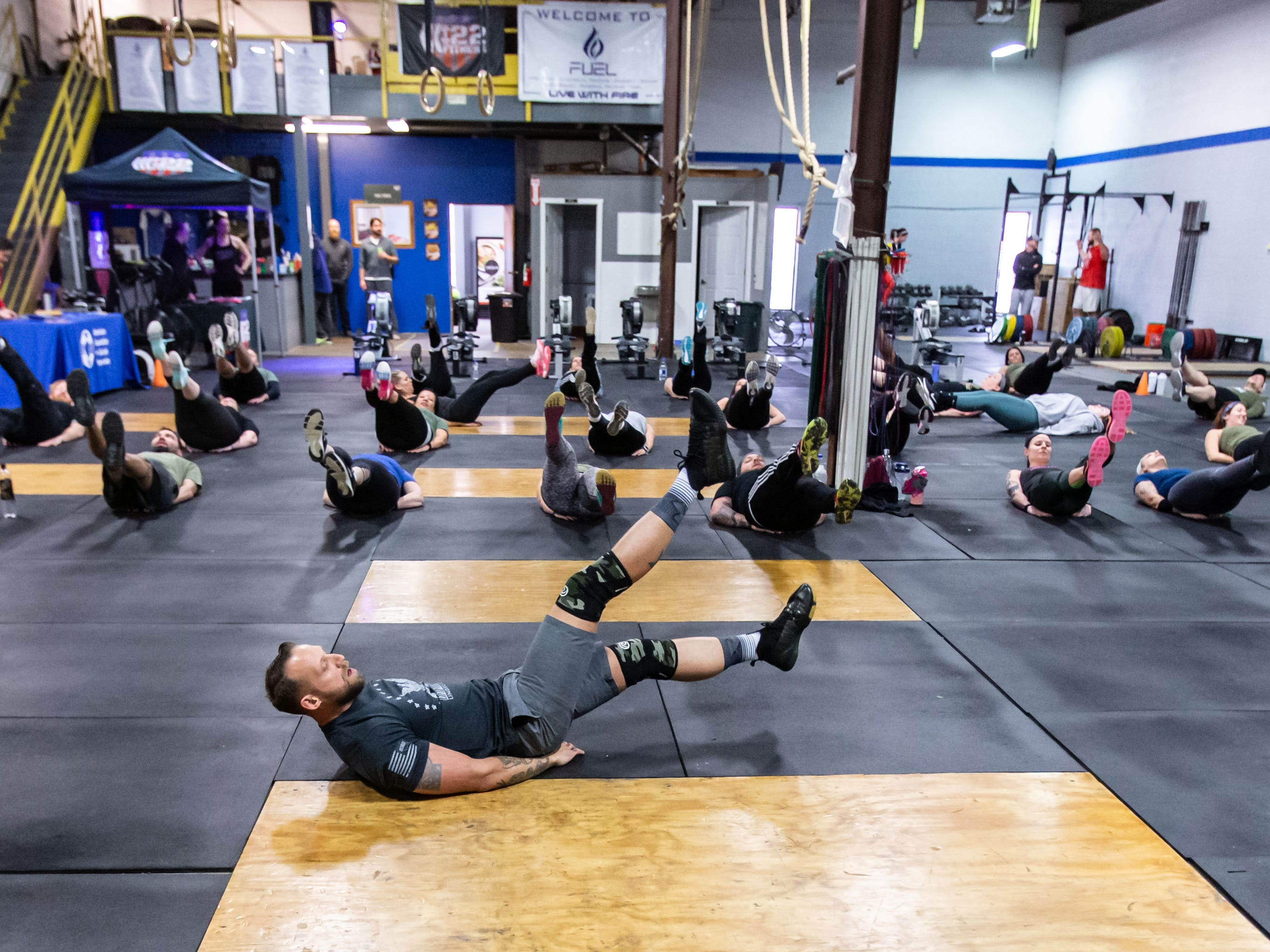 Army veteran Dan Newberry of Hales Corners leads participants through his weekly free fitness class at FUEL Fitness in Oak Creek on Sunday, Jan. 6, 2019. Dan's organization, 22 Fitness Foundation Inc., is collecting donations for the American Foundation for Suicide Prevention (AFSP). The Jan. 6 class was a fundraiser and informational gathering for the AFSP.
