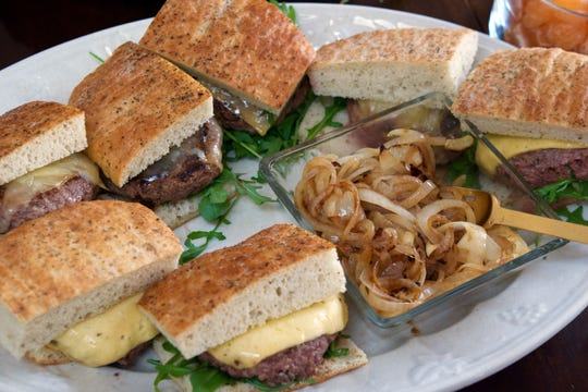 Chianti burgers, nestled between slices of   focaccia, are served with caramelized onions.