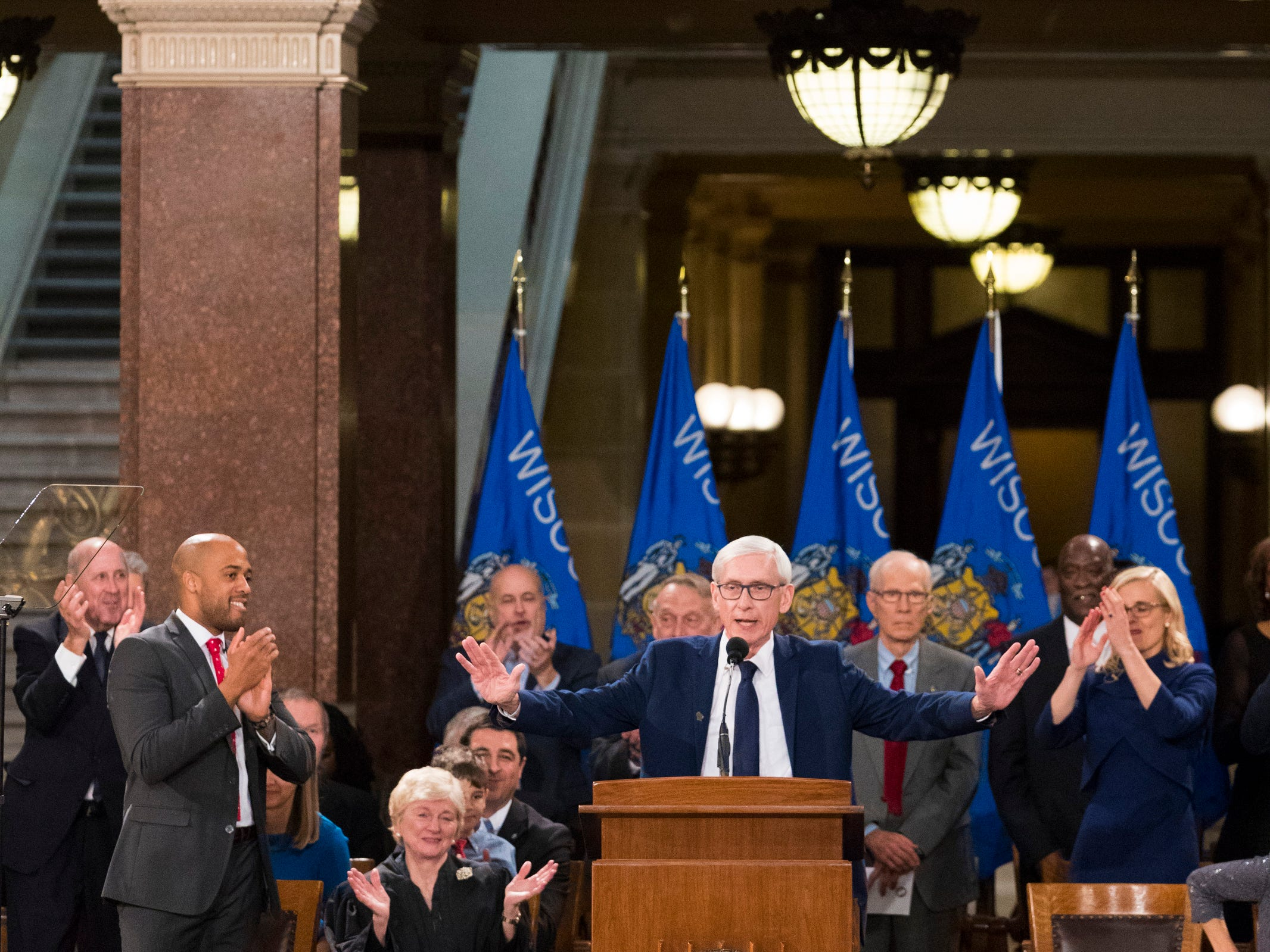Newly sworn-in Gov. Tony Evers acknowledges the crowd during the inaugural for the state's constitutional officers at the Capitol in Madison, Wis.