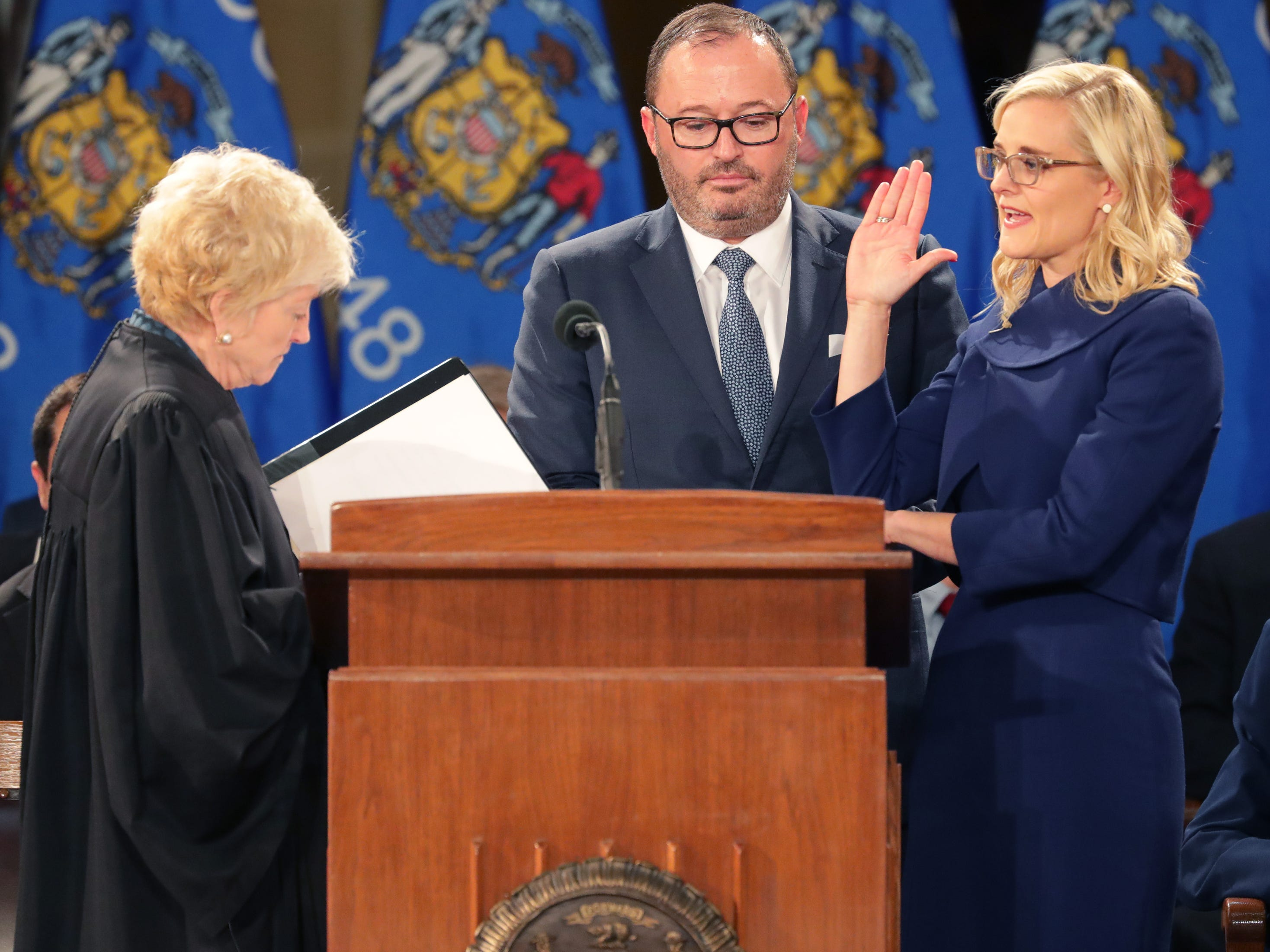 Chief Justice Patience D. Roggensack (left) administers the oath of office to State Treasurer Sarah Godlewski.