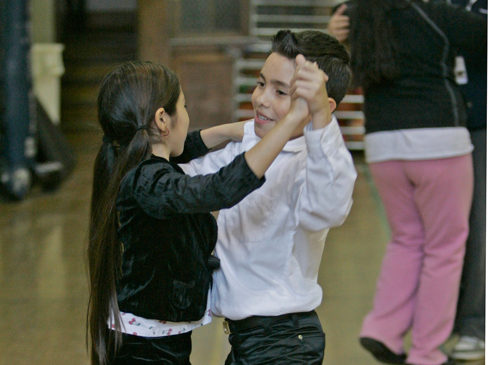 2008: America Espinosa, left, and Daniel Morillo, both 11,  dance the fox trot during the Mad Hot Ballroom and Tap program, sponsored by Danceworks, at Vieau Elementary School,  823 S. 4th Street, Milwaukee.