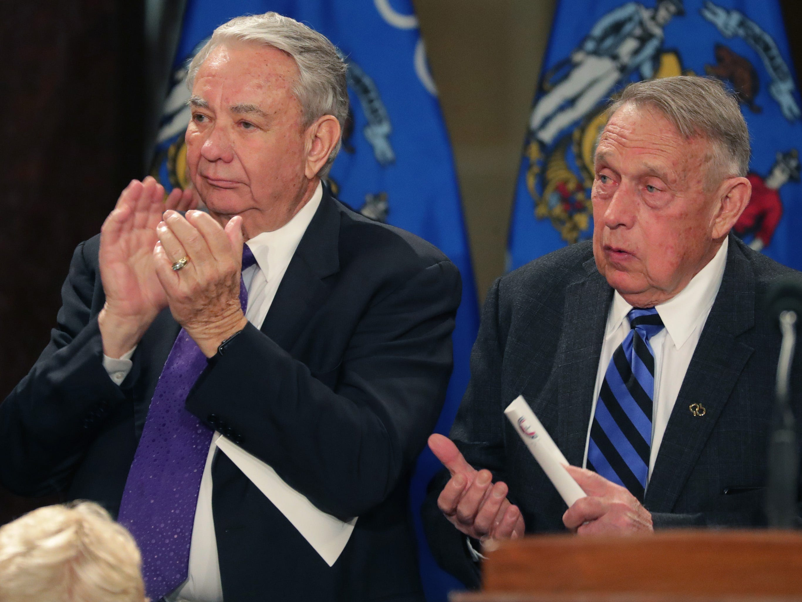 Former Govs. Tommy Thompson (left) and Martin Schreiber are shown during the ceremony.