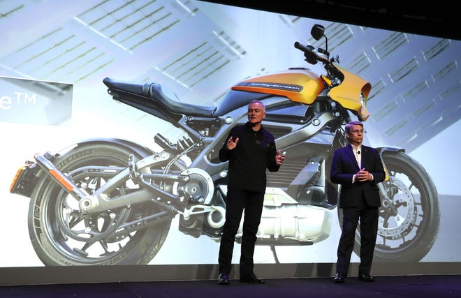 Marc McCallister (left), vice president of Consumer Portfolio Management with Harley-Davidson, talks about the the new Harley-Davidson LiveWire electric motorcycle with Panasonic North America Chairman and CEO Tom Gebhardt on Monday during CES 2019 at the Mandalay Bay Convention Center in Las Vegas. CES, the world's largest annual consumer technology trade show, runs through Friday and features about 4,500 exhibitors showing off their latest products and services to more than 180,000 attendees.