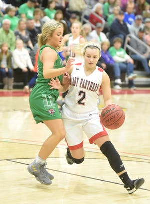 Norfork's Whitlee Layne drives past Valley Springs' Madison Moore on Saturday night at the NorthArk tournament. Norfork, the No. 1 team in Class 1A, defeated Valley Springs, the No. 4 team in 3A, 68-66, in the championship.