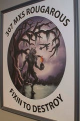 The Rougarou, a mythical werewolf popular in Cajun folklore, hangs on display in a painting created by U.S. Air Force Staff Sgt. Ashley Johnson for the 307th Maintenance Squadron at Barksdale Air Force Base, Louisiana.  The Rougarou serves as the mascot for the unit. A Reserve Citizen Airman, Johnson has used her talent as an artist to create similar paintings for other units in the 307th Bomb Wing.  (U.S. Air Force photo by Master Sgt. Ted Daigle)