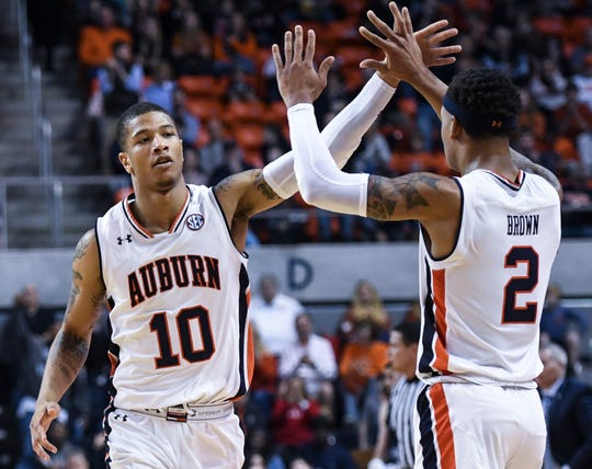 Auburn guard Samir Doughty (10) and Auburn guard Bryce Brown (2) celebrate a score against North Florida during the first half of an NCAA college basketball game Saturday, Dec. 29, 2018, in Auburn, Ala. (AP Photo/Julie Bennett)