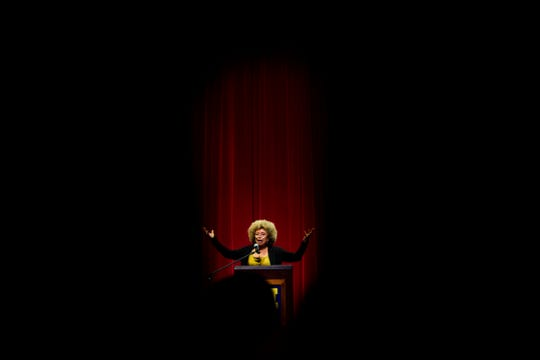 FILE- In this Feb. 19, 2015, file photo Angela Davis, author, educator and iconic civil rights activist, speaks during her visit to the University of Michigan-Flint, in Flint, Mich. The Birmingham Civil Rights Institute in Alabama announced Saturday, Jan. 5, 2019, that it has rescinded its decision to honor Davis following unspecified complaints. Davis is a Birmingham native who has spent decades fighting for civil rights. (Jake May/The Flint Journal via AP, File)