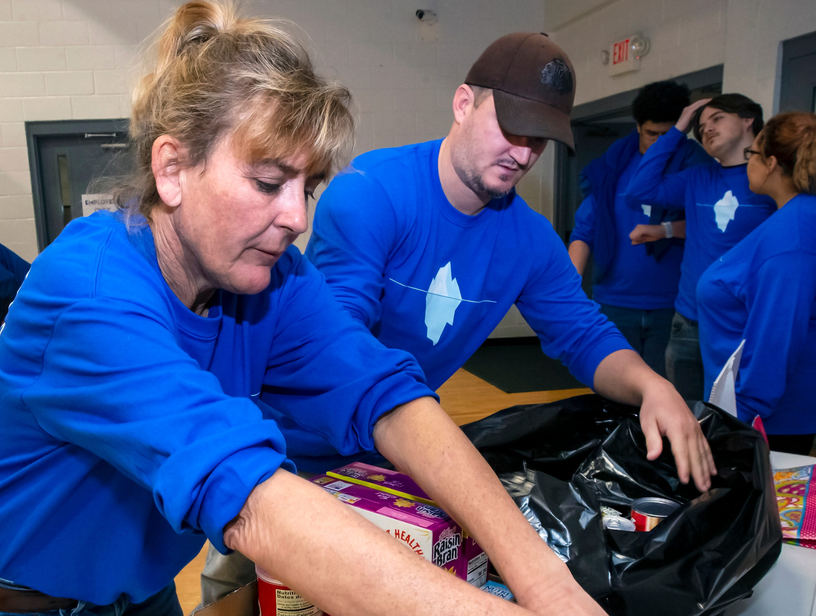 Marta Morgan and John Rupar bag donated items at the 17th annual Polar Bear Plunge held at SportsCom on Saturday, Jan. 5, 2019. Several large bags of food was taken to Greenhouse Ministries for their food bank.