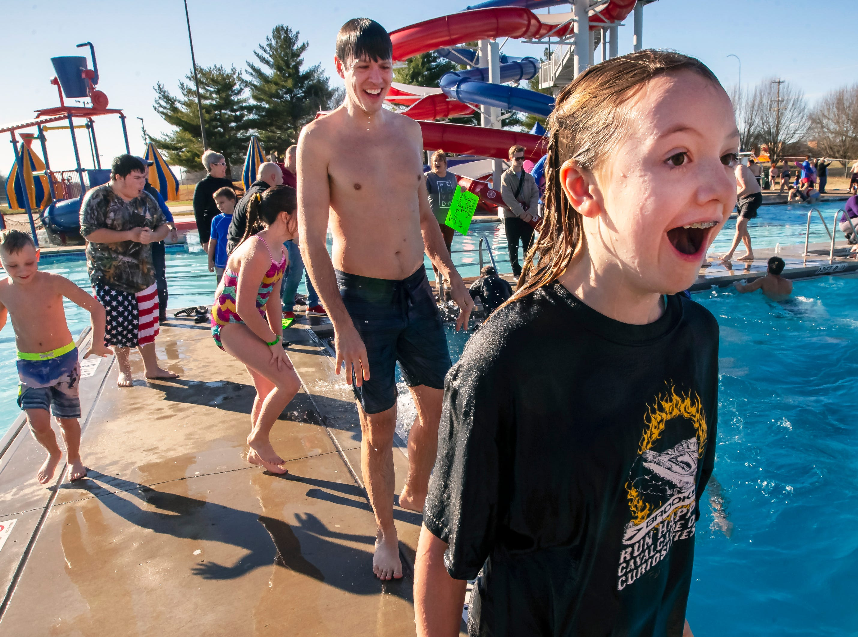 Kenady Walker reacts to the cold water after jumping into the pool at the 17th annual Polar Bear Plunge held at SportsCom Jan. 5, 2019.