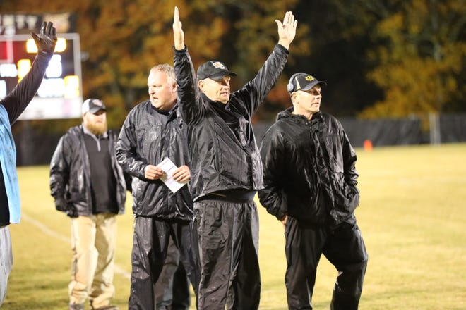 Rick Rice signals touchdown during a recent Wayne County football game. Rice was named Rockvale High's first head football coach Monday.