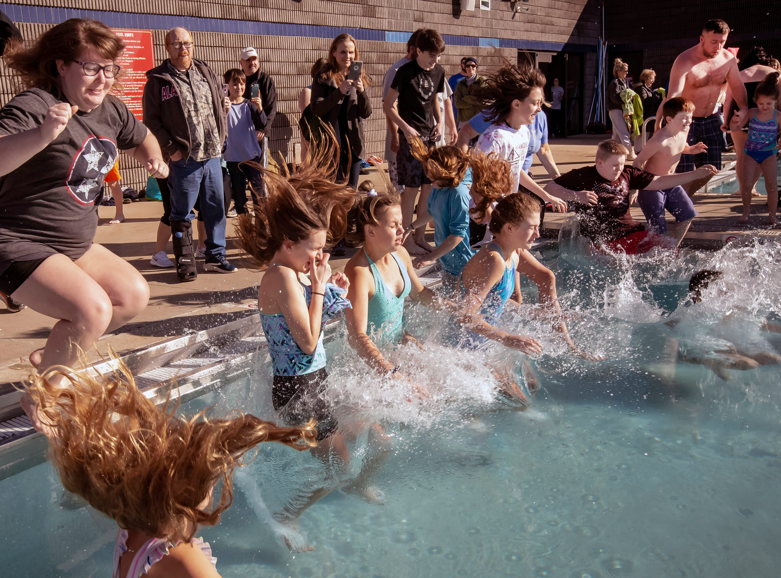 Polar Bear Plunge participants jump into Jumping into the water at the 17th annual Polar Bear Plunge held at Sports Com Jan. 5, 2019.