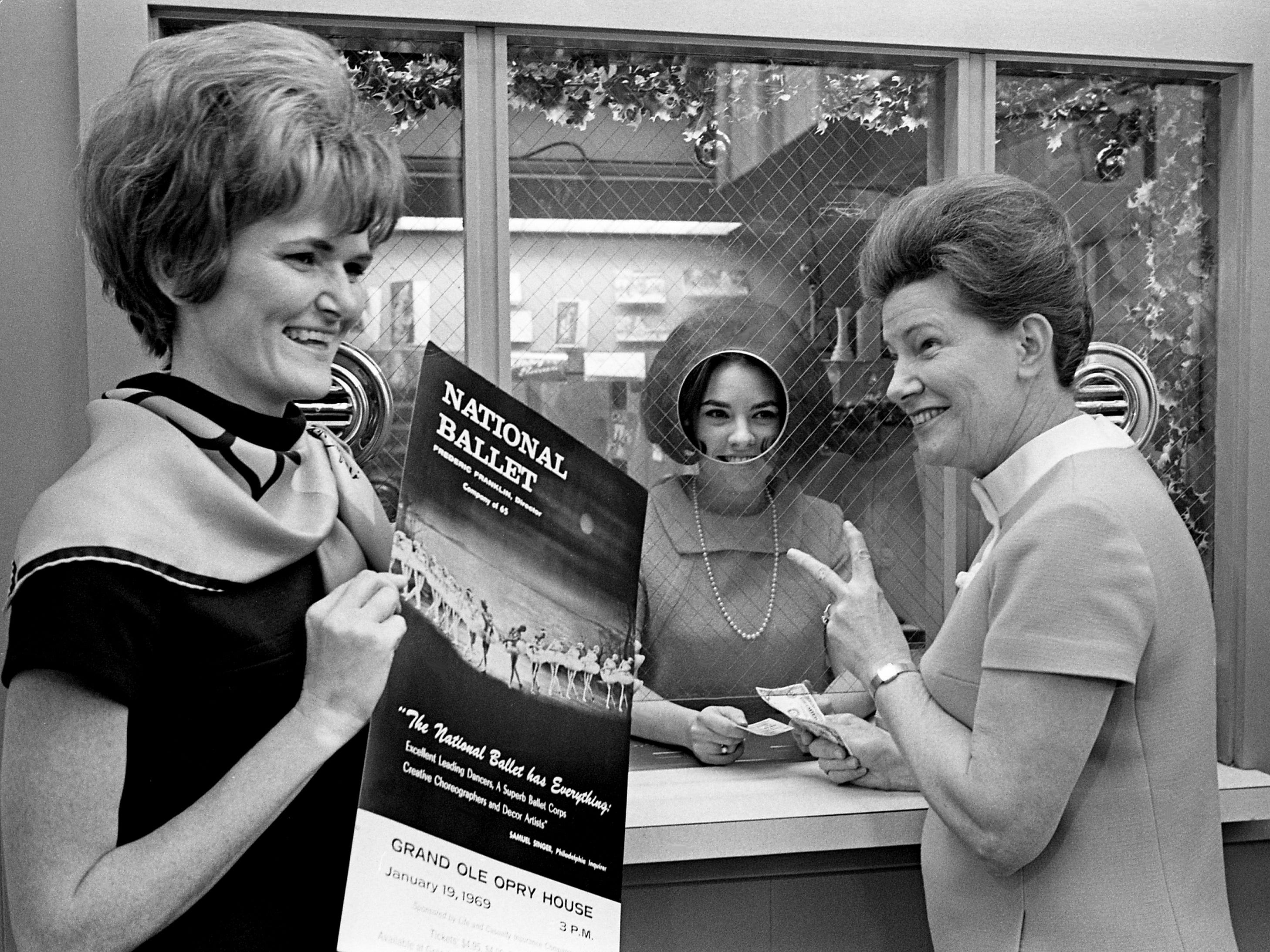 Minnie Pearl, right, first lady of the Grand Ole Opry, buys two tickets for the country's top ballet company, The National Ballet, at the Ryman Auditorium's ticket window Jan. 10, 1969. The classical ballet company, brought here by the Life and Casualty Insurance Co., will temporarily change the atmosphere at the Ryman on Jan. 19.