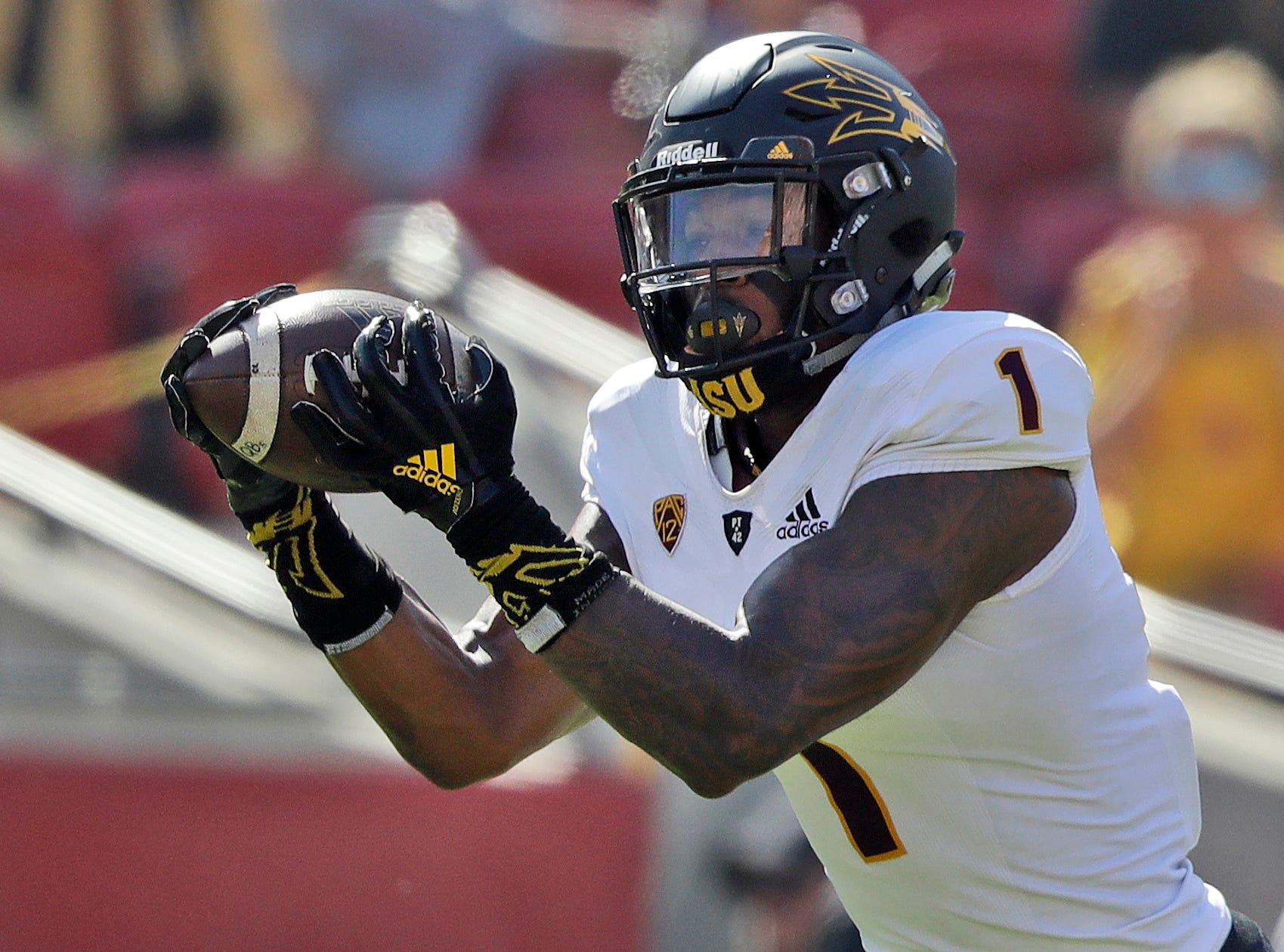 FILE - In this Oct. 27, 2018, file photo, Arizona State wide receiver N'Keal Harry makes a touchdown catch against Southern California during the first half of an NCAA college football game in Los Angeles. Harry announced Monday, Nov. 26, 2018, he will skip his senior season to enter the NFL draft.