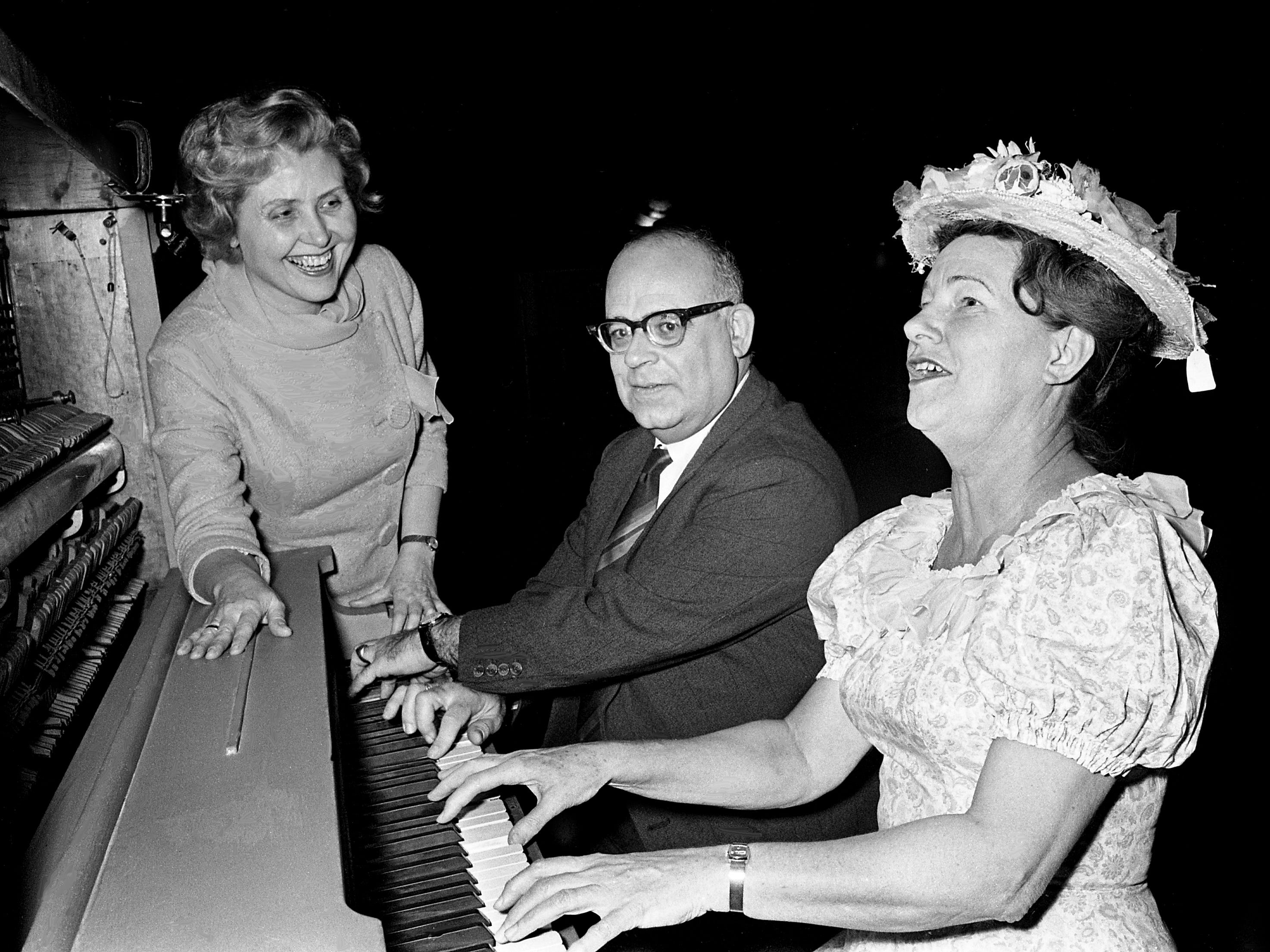 Soprano Signe Quale Dawson, left, and her pianist, Carl Fuerstner of Tennessee's unique traveling opera company, get a few lessons from Minnie Pearl during a visit to the Ryman Auditorium on Jan. 29, 1969.