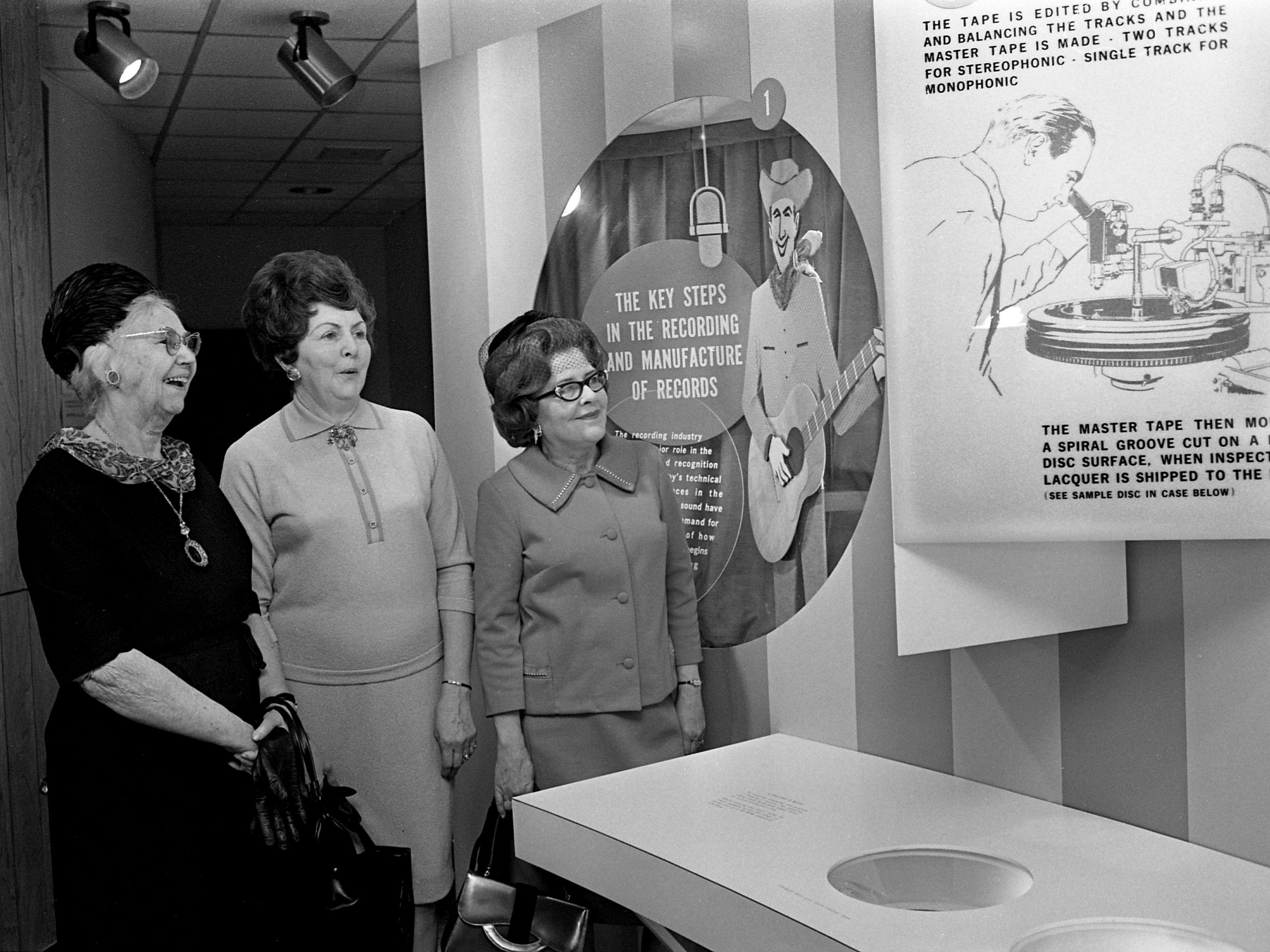 Mrs. W.R. Pardue, left, Mrs. Joe Lackey and Mrs. Clifford Allen, members of the Nashville Bar Auxiliary, check out one of the exhibits of the Country Music Hall of Fame after their luncheon at the site Jan. 30, 1969.