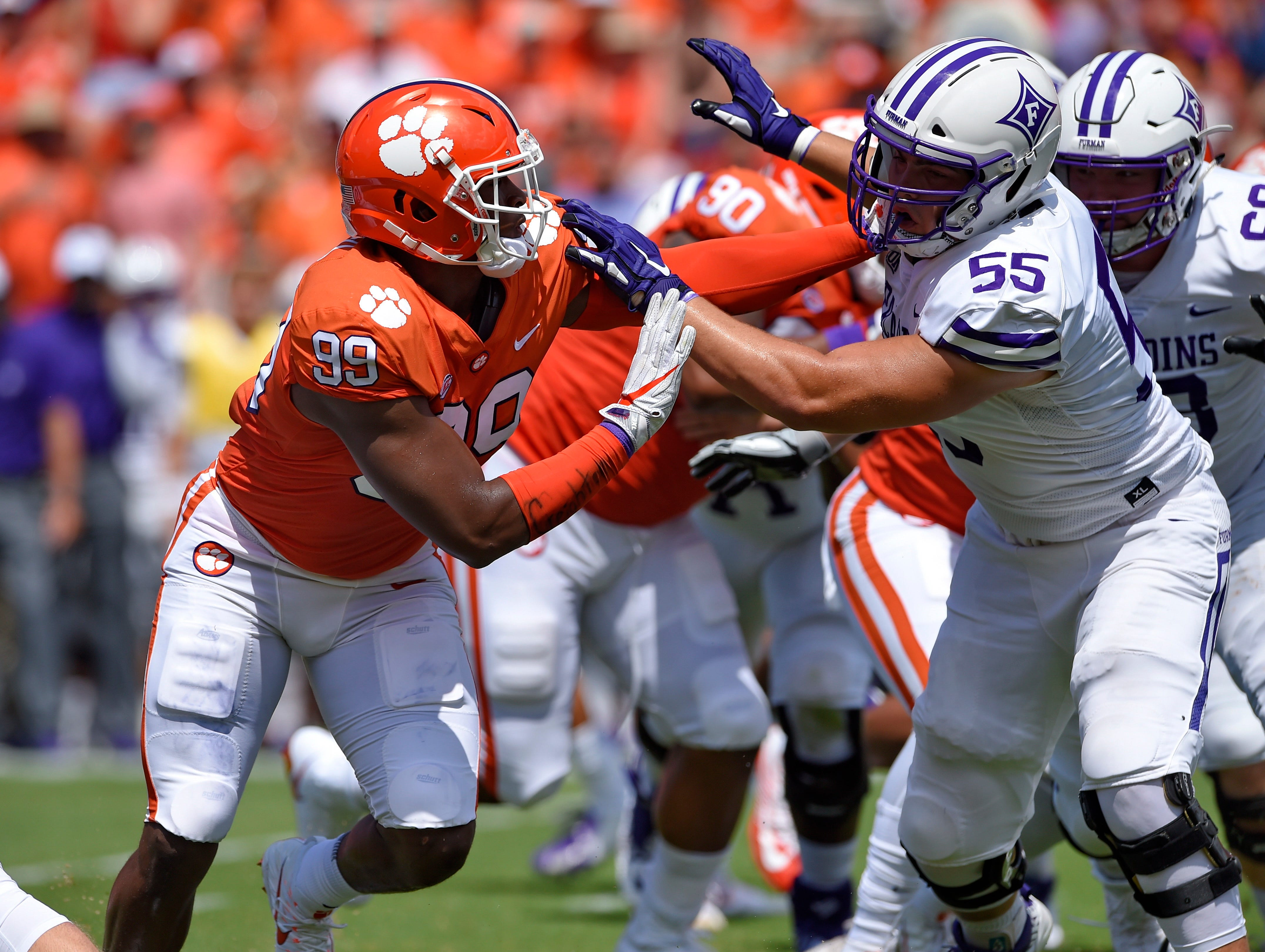 Clemson's Clelin Ferrell (99) battles with Furman's Bo Layton during the first half of an NCAA college football game Saturday, Sept. 1, 2018, in Clemson, S.C. Clemson won 48-7.