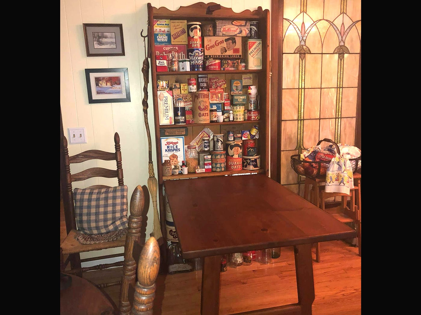 This antique fold-up breakfast table also displays Kathleen Walter's vintage tin collection.