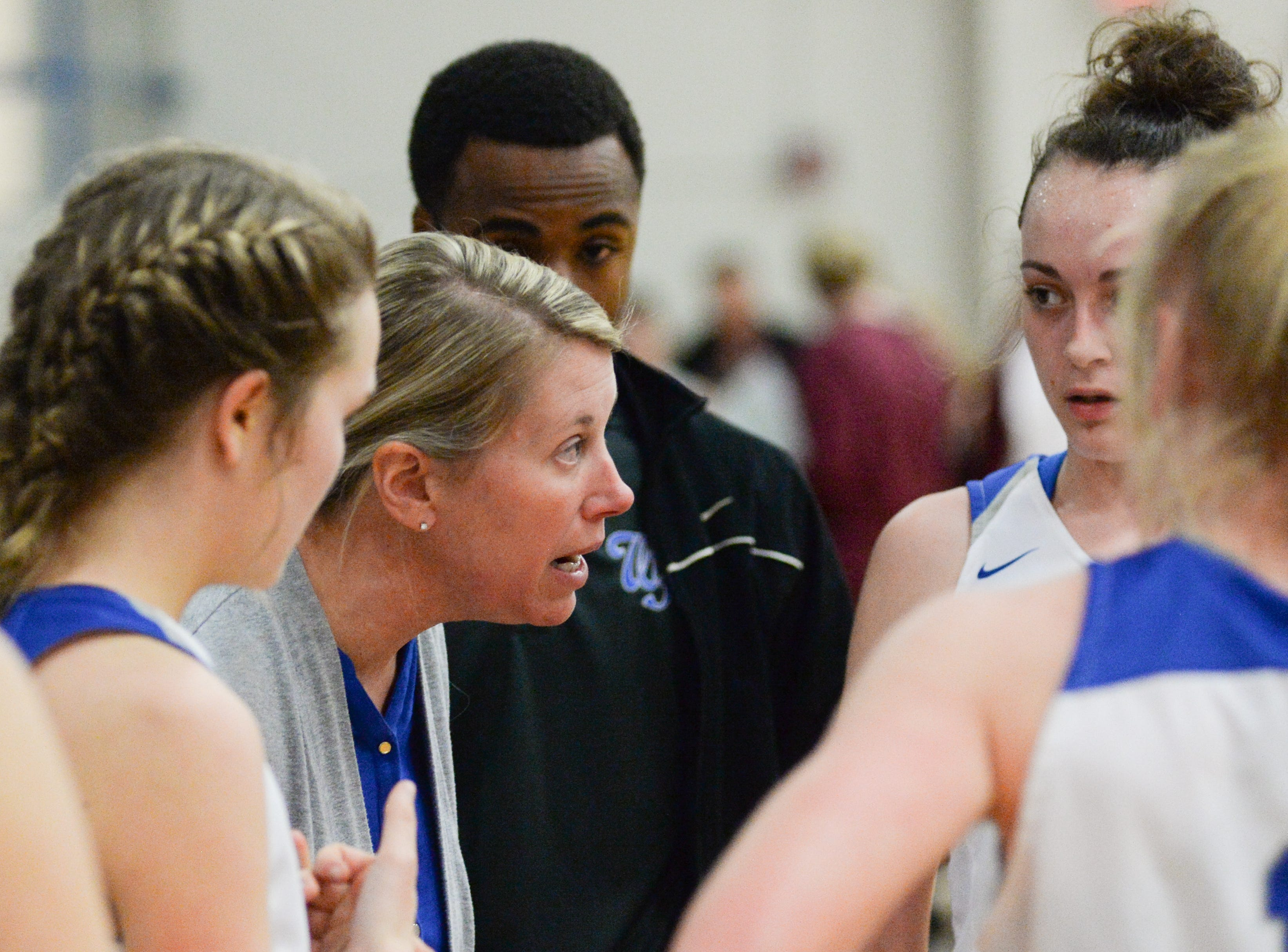 White House High School girls basketball coach Kelly Smelcer talks with players during a game against East Robertson High School at White House High School on Friday, Jan. 4. White House won 56-31.